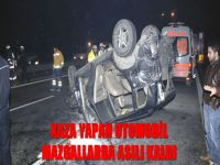 Kaza yapan otomobil mazgallarda asılı kaldı